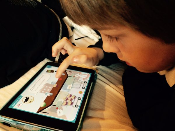 Photo: Child using tablet computer