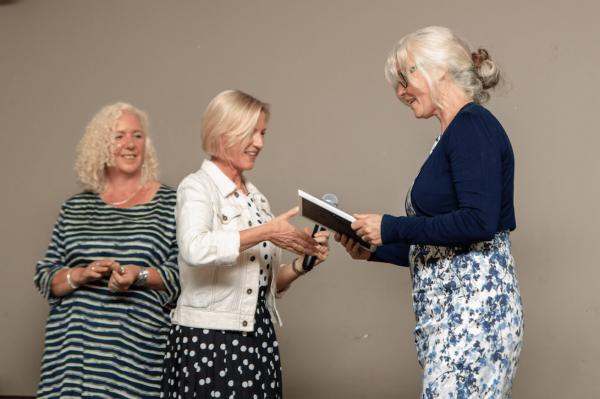 Photo: woman collecting award