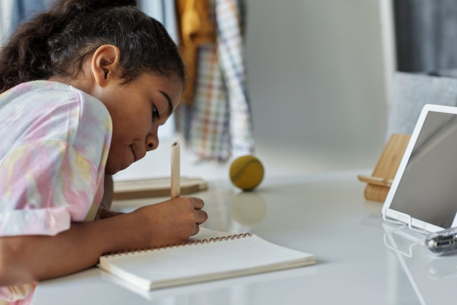 Canva - Photo of Girl Writing on White Paper